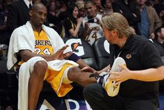 Kobe gets kinesiology taped for an Edema on his shin