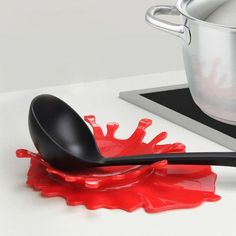 Make a splash in your kitchen with the Splash Spoon Rest! Designed to look like a splash of red pasta sauce, it's the perfect kitchen utensil rest or holder.