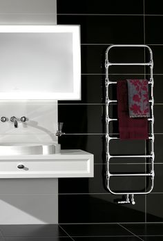 Zehnder Nobis and its high quality chrome finished tubes bring a special look to every bathroom. The large spacing between the tubes combines distinctive character with functionality. Several towels can be heated at the same time. Diy Bathroom, Traditional Bathroom, Bathroom Towel Rails, Towel, Painting Bathtub, Bath Towel Racks, Towel Rack, Towel Radiator, Decorative Radiators