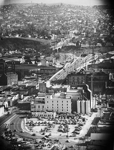 An southeastward aerial view along the Aliso Street future route of the Route 101 Hollywood Freeway past the Maier-Brew 102 brewery in downtown Los Angeles (ca. 1940)