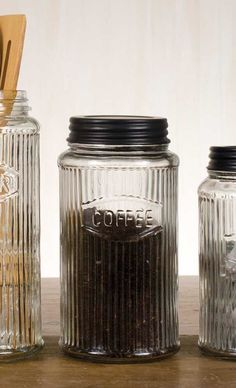 """Hoosier Coffee Jar is the perfect glass canister to store your coffee. It reads """"Coffee"""". Clear glass with a black lid. Give your kitchen some classic vintage style with all four of our kitchen Hoosier jars. Coffee Jars, Coffee Canister, Glass Canisters, Canister Sets, Glass Jars, Sugar Canister, Clear Glass, Mason Jars, Tea Jar"""