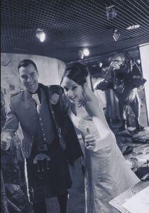 Our bride and groom making a narrow escape from Dynamic Earths Sabre-tooth Cat #Dynamicearth #Weddingvenue #Sabretoothcat