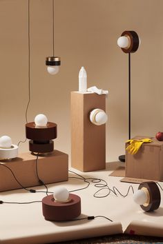 Haos' debut collection features ceramic cylinders with brass and glass components that come together to create seven lamps in cognac, brick, white or black colours.