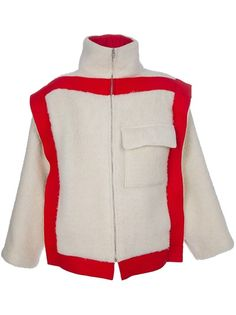 Nude wool jacket from JC de Castelbajac Vintage featuring a stand-up collar, a silver-tone front zip fastening, a front jetted flap pocket to the chest, long wide sleeves and contrasting red panels to the front and back.