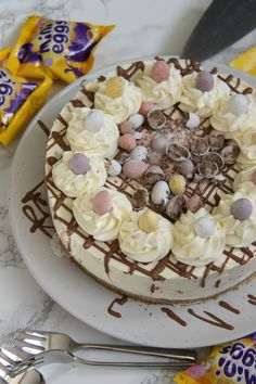 A Delicious & Sweet No-Bake Vanilla Mini Egg Cheesecake with a Buttery Biscuit Base, full to the brim with Mini Eggs – Perfect *non*bake for...
