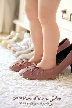 Reminds me of when I was a little girl wearing my mom's heels around the house playing dress up.