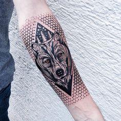 dotwork and geometric wolf sleeve tattoo