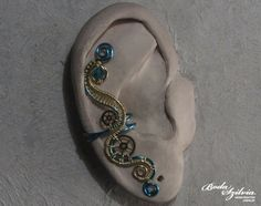 ELECTRIC STEAMPUNK  brass and ice blue ear cuff by bodaszilvia, $19.50