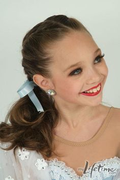 Maddie from Dance Moms. Always at the top of the pyramid, but always wants to see the other girl suceed too! :)