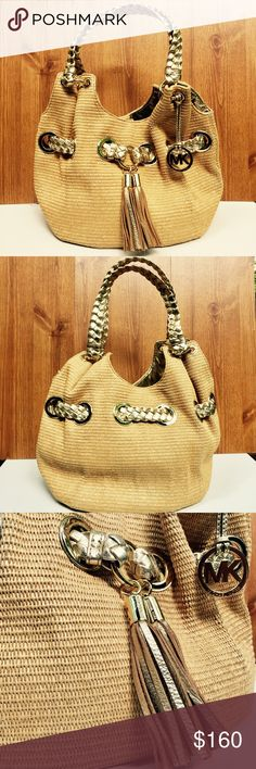 """Michael Kors Marina Large Gathered Bucket Tote It's previously loved and still absolutely beautiful. It's a woven with a straw material and gold metallic leather. It has 20"""" braided leather straps. The lining is just beautiful and has 4 open pockets and one zippered pocket and is so very roomy! This bag is in fact BIG. It's 17"""" L , 11 1/2"""" H X 8 1/2"""" W. it has a magnetic closure. Michael Kors Bags"""