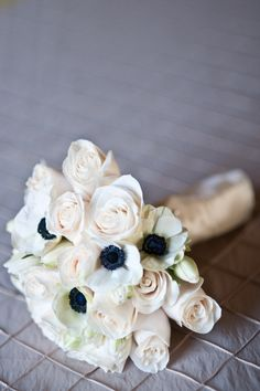 This is exactly what I'm looking for - Dark centered anemones with delicate cream colored roses!