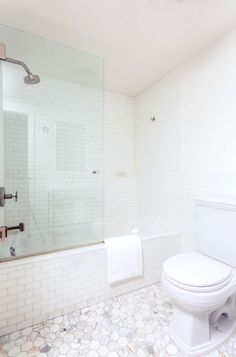 Don't you love the subtlety of the subway tile? Who said a beautiful room needs more than one color? From One Fine Stay