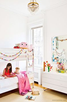 one of my favorite little girl rooms!  love this bright and white bunk bed with pops of color.