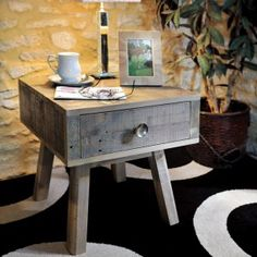 The Bainton Reclaimed lamp table is a contemporary design which has eye catching slender angled legs and retro metal drawer knobs.