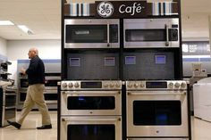 China's Haier Nears Deal to Buy GE Appliance Business Outdoor Cooking Area, Exhaust Hood, Cafe Shop, Outdoor Kitchen Design, Cooking On The Grill, Hush Puppies, Kitchen Appliances, China, Things To Sell