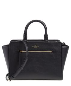 Carrying all of the stylish essentials in this structured and elegant Kate Spade leather satchel.