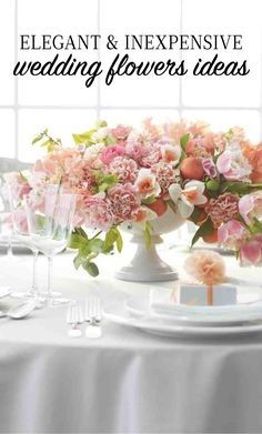 """Elegant and Inexpensive Wedding Flower Ideas   Martha Stewart Weddings - Freewheeling centerpieces in cheery colors practically shout """"party time!"""" Here, fringed tulips and fruiting clementine branches create lush overhang from a compote (the perfect vessel for a large arrangement), while picotee-edged carnations, daffodils, sweetpeas, and ranunculus add volume."""