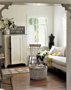 Farmhouse decor in a living room with casual country style and design. Vintage c… Farmhouse decor in a living room with casual country style and design. Vintage country cabinet, rustic wood floors, antique sign, and dress form decorate the room. Country Decor, Farmhouse Decor, Country Living, Farmhouse Style, Country Style, Vintage Country, French Country, Vintage Farmhouse, White Farmhouse