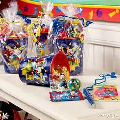 Mickey Mouse party favors start with a cute container! We love using a reusable plastic cup.