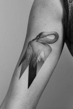 Surreal transparent swan tattoo by Paweł Indulski