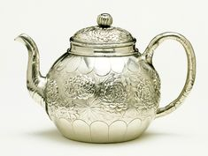 Teapot Konoike 1890-1895 Yokohama, Japan Silver repoussé Konoike was specially commissioned to make this teapot by Liberty and Company. The design of chrysanthemums is a traditional Japanese one, but the form of the vessel is western