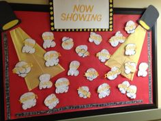 my lights, camera, action! bulletin board. the film is made with little pictures of the kids that is laminated