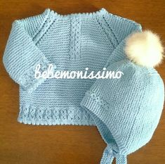 Top-down raglan baby sweater. Eyelet cable and picot borders ~~ Bebemonissimo