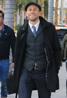 Dapper:The 36-year-old beaming actor was seen leaving the Prada store in a waist coat with a button up shirt and tie