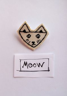 Embroidered cat brooch in black and white with by AnAstridEndeavor, $10.00