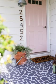Welcoming pink front door for the farmhouse.