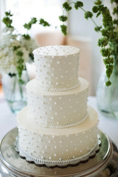 classic white wedding cake with swiss dots