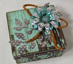 Exploring Creativity altered box with metal flower embellishments