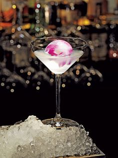 White Cosmo Orchid Ice Ball- Daniel in NYC Bartenders freeze a bright orchid into a perfect sphere of ice, which comes floating in your glass like a magenta globe. #cocktails #drinks #happyhour