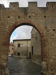 The old gate to the medieval village of Magliano in Toscana, Silver Coast, Maremma, Tuscany, Italy