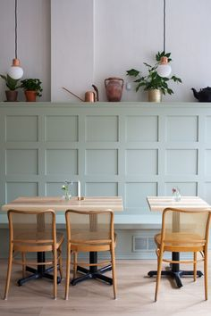 A banquette in pale green (by way of Farrow & Ball paint) is paired with Austrian caned chairs. Photograph by Juli Daoust Baker from Mjölk Made: A Canadian Cafe Gets a Scandi Revamp from Toronto's Cult Design Couple. Green Dining Room, Dining Room Design, Dining Room Furniture, Dining Room Paneling, Wood Paneling, Wall Panelling, Dining Area, Farrow Ball, Cafe Bench
