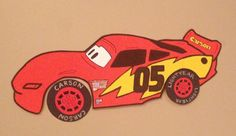 Race car birthday party idea: Pin the Tire on Lightning McQueen. Each kid will receive a customized front tire. Lightning McQueen is the size of a poster board.