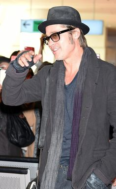 Brad Pitt's fans had him smiling in Tokyo on Friday.