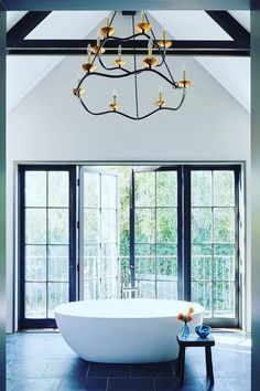 A little R&R to start the weekend 💛 featuring our Choros Two-Tier Chandelier by Barry Goralnick. Inspiration courtesy of @cordova_studio. 📸 @dominiquevorillon #circalighting Circa Lighting, Candelabra, Lighting Design, Canopy, Chandelier, Bath, Black And White, Studio, Inspiration