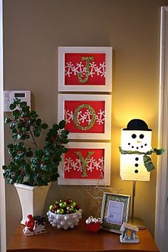 Christmas Decor, for the joy, walmart for the frames, your fav wrapping papers, cut one color of the wrapping paper to fit inside the frame and using the other wrapping paper, cut the letters out. double sided tape and there you go.  and u don't have to use white frames.  use whatever color or colors.  who said it had to all be the same? lol  have fun with it.