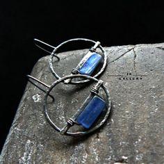 swing Biżuteria Kolczyki Jola Krajewska. Love the rustic quality of the metal and the deep blue.
