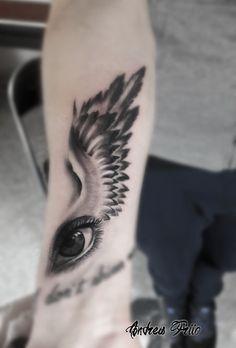 black and grey tattoo eye tattoo wings tattoo