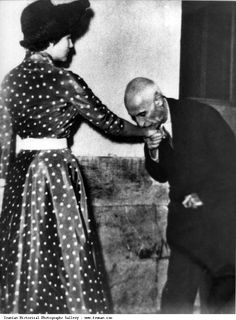 Pahlavi Prime Minister Dr. Mosaddegh Kissing the hand of Queen Sorayya Esfandiari, Mohammad Reza Shah's second wife