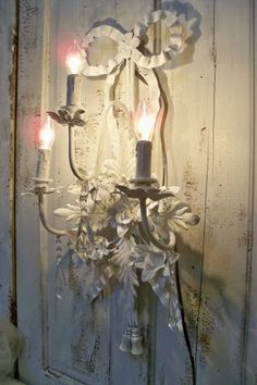 Beautiful chalk white French Nordic style sconce.  http://www.anitasperodesign.com/