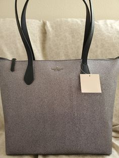 Brand new Kate Spade tote. Has two interior slip pockets and one zip pocket.  Color: Dusk Navy Kate Spade Totes, Kate Spade Tote Bag, Leather Totes, Large Tote, Dusk, Tote Bags, Bling, Trends, Pockets