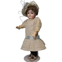13-1/2 Kestner German bisque doll, marked only with the size, 8. This pouty faced girl with chubby rosy cheeks and a double chin has a closed mouth