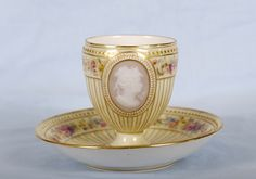Antique Meissen Pate Sur Pate tea Cup with Medalion and Saucer .