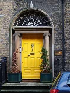 Yellow doors bring sunshine to an otherwise dreary space