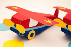 "Our lil' airplane will take off with your guests at the end of the party! Our GO AIRPLANE Printable Favor Box includes: • Printable airplane box (1 per 1.5 pages) • Assembled box is 1 7/8"" w x 1 7/8"" h x 5 3/4"" d (excluding 6 7/16"" wing, wheels and rudder) • Printing and assembly required ..."