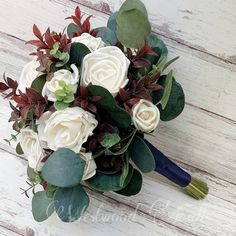Sola wood flower bouquet with eucalyptus and navy ribbon. Perfect keepsake for bride or bridemaid after the wedding. Wood Flower Bouquet, Sola Wood Flowers, Navy Ribbon, Floral Wreath, Wreaths, Bride, Wedding, Wedding Bride, Valentines Day Weddings