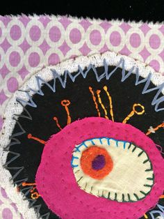 By Maggie Muth-embroidery collage on felted sweater, cheesecloth, linen and scraps using button hole stitch and free form stitching